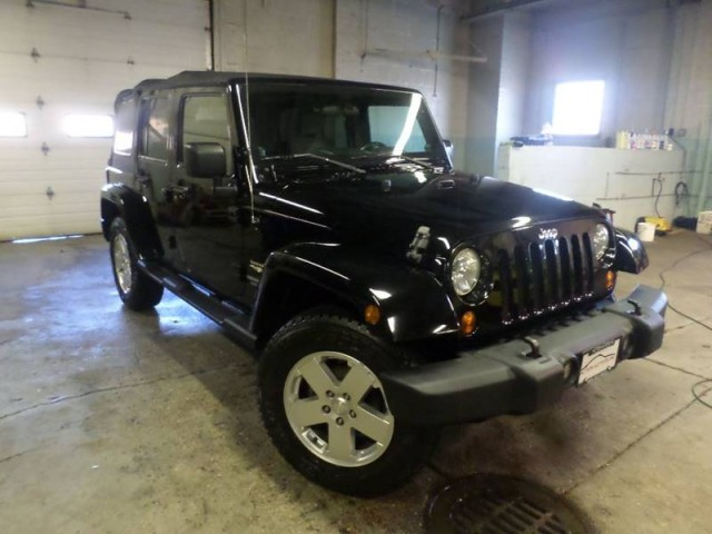 2010 JEEP WRANGLER UNLIMI SAHARA for sale at Action Motors