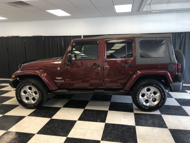 2009 JEEP WRANGLER UNLIMI SAHARA for sale at Stewart Auto Group