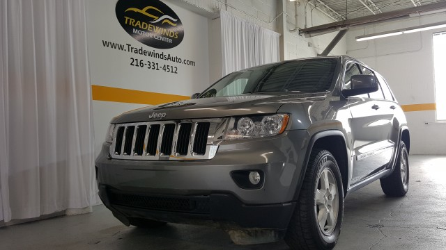 2011 JEEP GRAND CHEROKEE LAREDO for sale at Tradewinds Motor Center