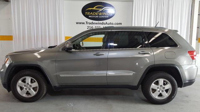 2011 JEEP GRAND CHEROKEE LAREDO for sale at Tradewinds Motor Center