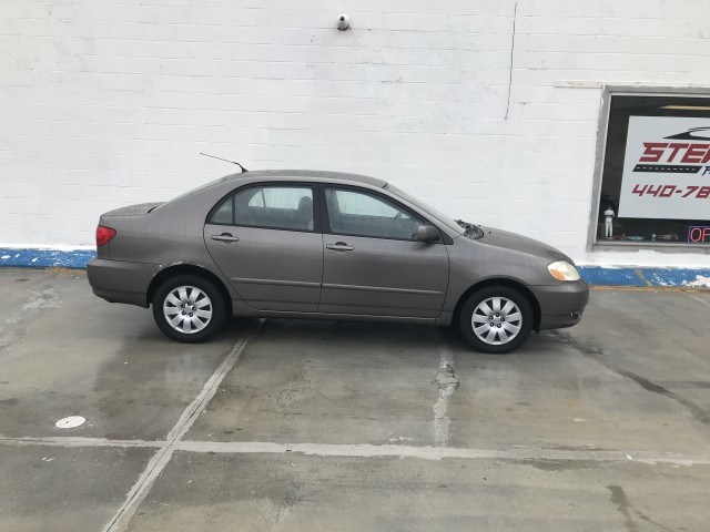 2003 TOYOTA COROLLA CE for sale at Stewart Auto Group